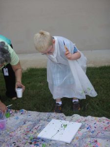 DANNY PAINTING OUTSIDE